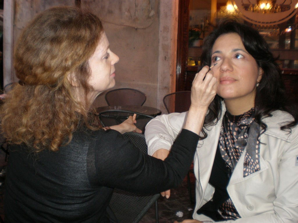 Makeup artist applying makeup in Piazza Farnese