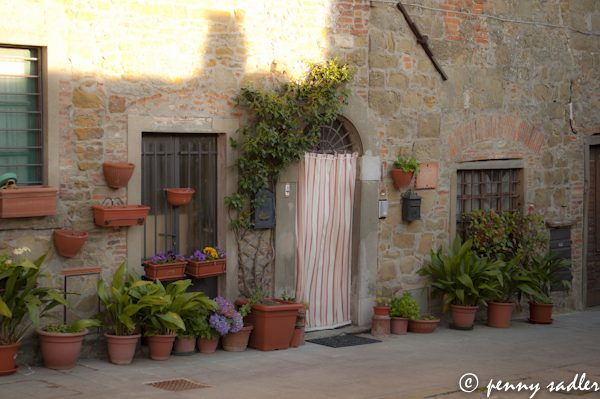 Beautiful doorway with flower pots in small town i Chianti ©PennySadler 2013