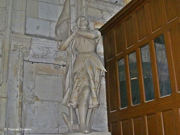 off the beaten path in Normandy. A marble statue of Joan of Arc. @Thomas Dowson.