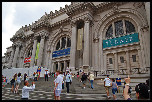 Crowds gather outside The Metropolitan Museum of art.