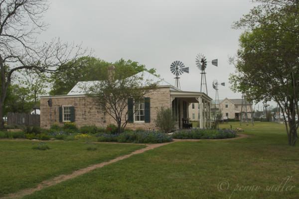 windmills and old limestone buildings in Fredericksburg, Texas