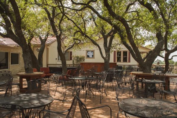 Outdoor seating under oak trees from 36 Hours in Fredericksburg @PennySadler 2015