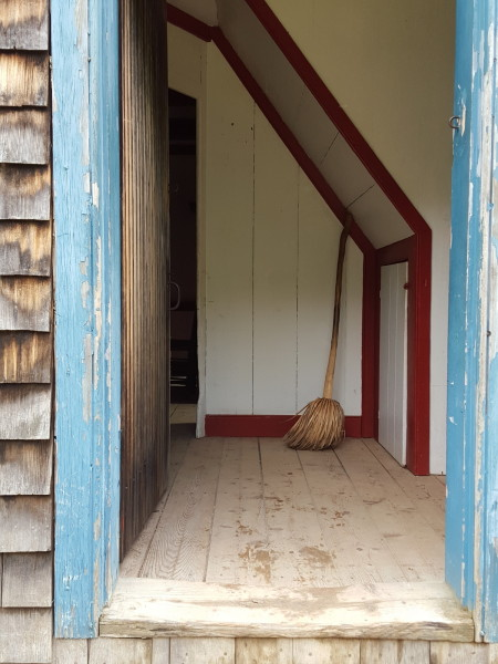 Looking through a door at Village Historique Acadien