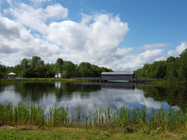 An old (1900) covered bridge divided more than time periods at Village Historique Acadien
