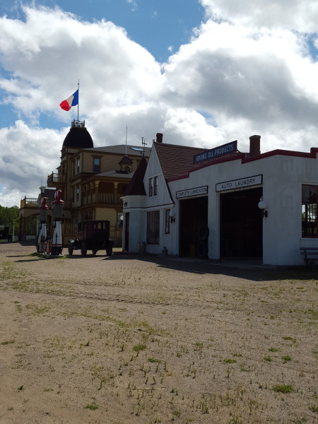 Oil Company and gas station, 1936; Hotel Chateau Albert, 1907 at the Village Historique Acadien