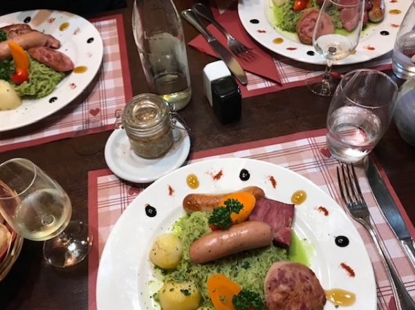 Green sauerkraut and sausages From Wine, Castles and Culture: Top Reasons To visit Riquewihr, Alsace.